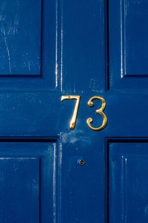 House number 73 Stock Photo