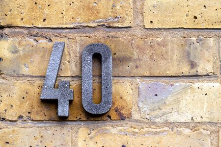 House number 40 on a brick wall