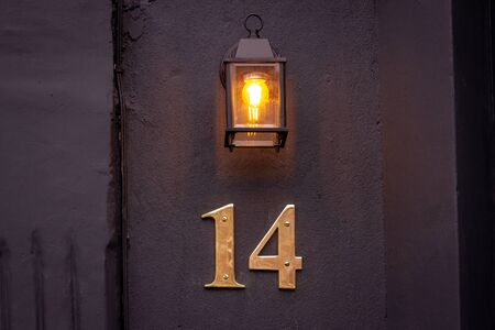 House number 14 lit from above