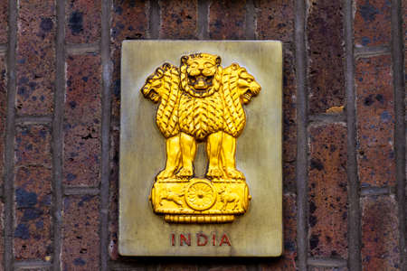 A representation of the Lion Capital of Ashoka was initially adopted as the emblem of the Dominion of India in December 1947 showing 4 lions facing in the four compass directions
