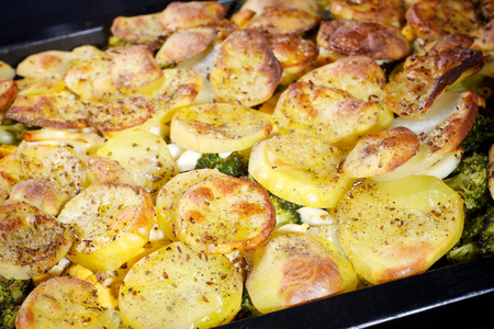 Baked french potatoes with vegetable