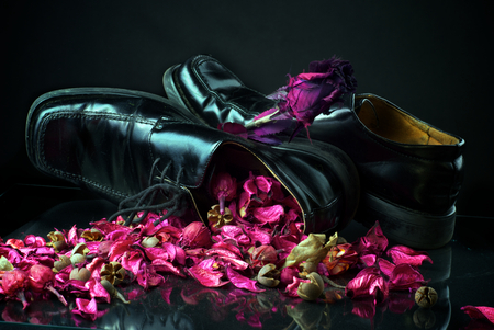 black wedding shoes with flowers photo