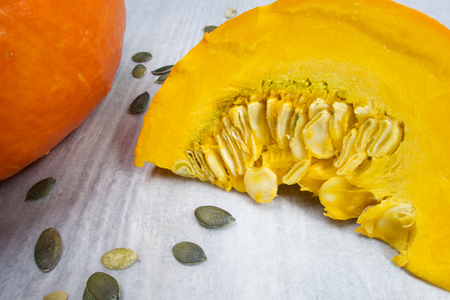 Orange vibrant pumpkin with seeds photo