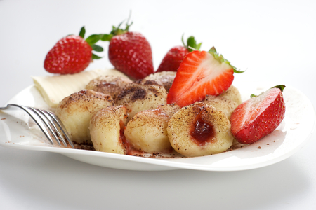 Delicious sweet dumplings stuffed with strawberries and cocoa photo