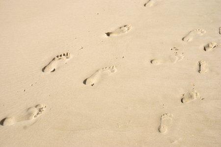 2 way: Footprints in sand at the Beach Stock Photo