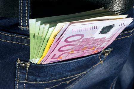 Money in blue jeans pocket photo