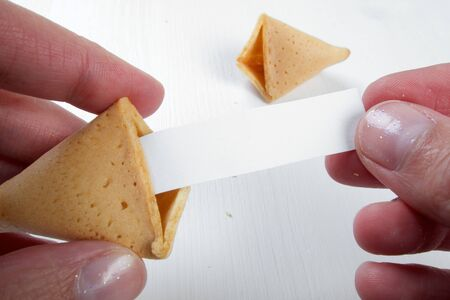 Fortune cookies in hands with advices, motivation mottos and blank space for copy Stock Photo