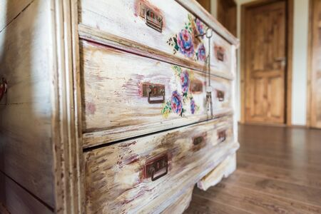 DIY concept, repair and renovation of old wooden furniture with floral decoration