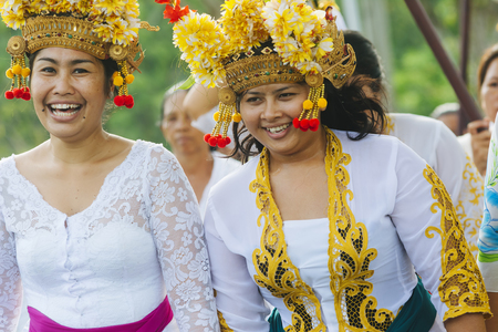 religious clothing: BALI, INDONESIA - MARCH 30: Balinese villagers participating in traditional religious Hindu procession before Ogoh-ogoh parade and Nyepi day (Balinese New Year) in Canggu, Bali on March 30, 2014