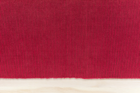 Red kitchen fabric napkin with stripes - background mockup with empty space on wooden table texture, top flat view Stock Photo
