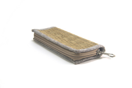Rattan texture wallet with zip isolated on white background with shadow, natural material and eco friendly product.
