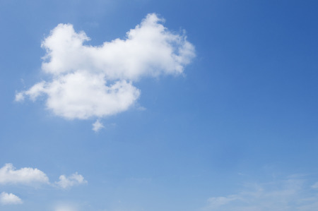 Feeling fresh air on brightly blue sky and a floating white cloud with copy space for text Banque d'images