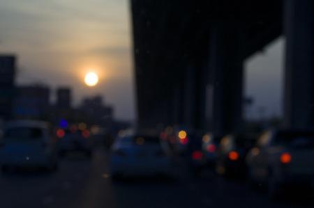Blurry scene of traffic jam on free way at dawn