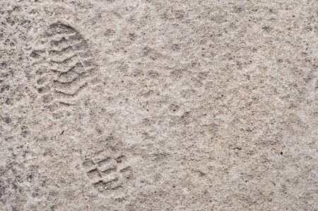 Man left boots footprint on concrete floor with copy space