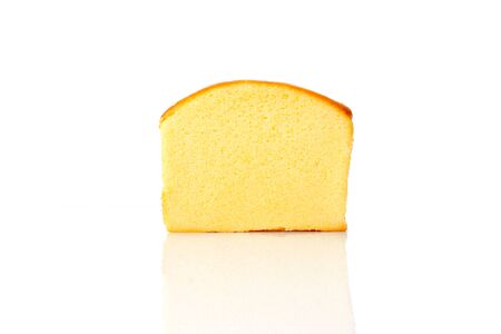 A piece of sliced butter cake isolated on white background,sweet bakery. Cut soft delicious pastry Banque d'images