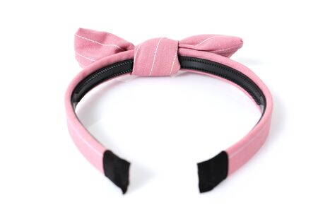 Pink hair band with ribbon isolated on white background, fashion hairstyle for girl. Hairdresser accessory and decoration for clothing and costume. Banque d'images
