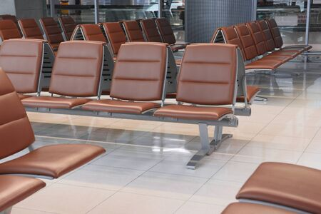 Seats for passengers in different row arrangement inside terminal before departure, interior area service in hall Banque d'images