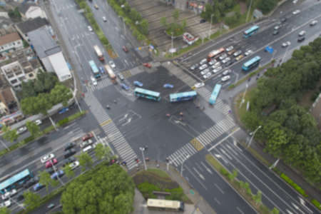 Blurry photo of main street junction from high angle view, transportation concept. Vehicles motion on road in China.