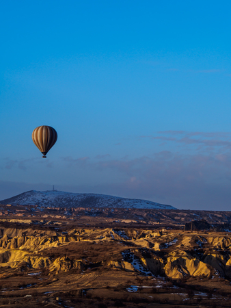 tinge: Hot air balloons flying over the mountain in Cappadocia Goreme National Park Turkey Stock Photo