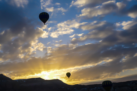 silhouette image , hot air balloon on the sky at sunrise background