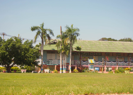 school building and grass field