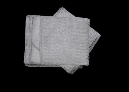 unfold: gauze pads on the black background