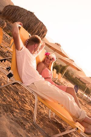 Lovers at the beach on an island photo