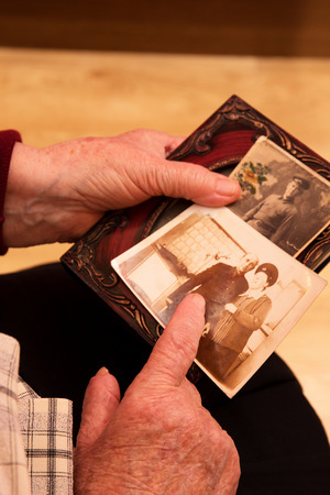 earlier: Grandma looked at the photos from earlier Stock Photo