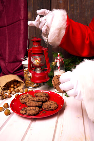 Santa Claus takes milk and cookies photo
