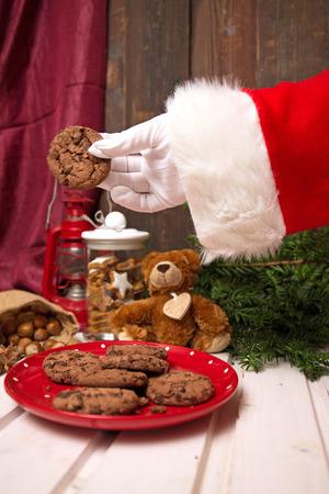 Santa Claus takes milk and cookies photo