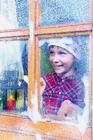 Boy waiting for Santa Claus photo