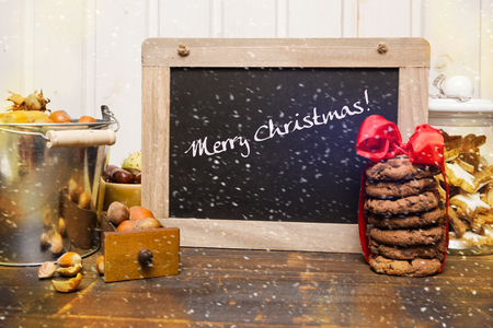 Sign panel on the wooden table with Christmas decoration photo