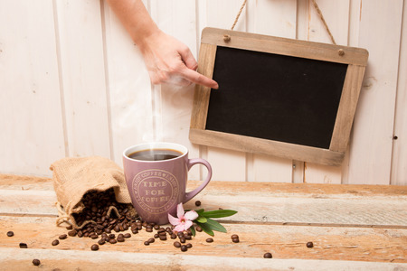 out of production: Cup of coffee with coffee beans