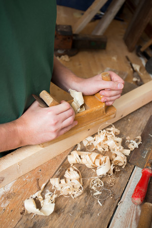 planer:  Carpenter with planer  Stock Photo