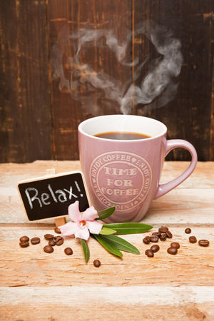 Cup of coffee with heart steaming photo