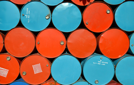 brent: colorful of old oil tanks after uesd at outdoor junk place photo in sun lighting.