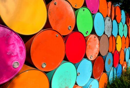 steel drum: colorful of old oil tanks after uesd at outdoor junk place photo in sun lighting.