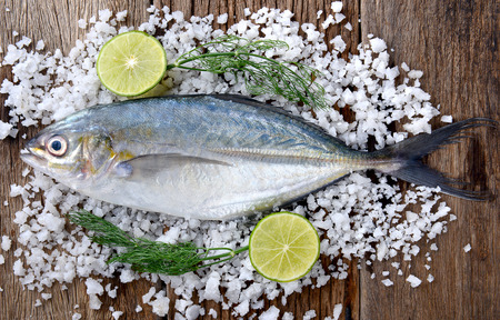 Trevally fish or jack frozen  with lemon and salt fresh from fishery market ready to cooking. Stock Photo