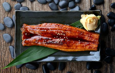 Japanese eel grilled or Unagi ibaraki set on plate in Japanese style with studio lighting.