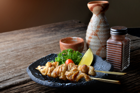 Chicken skin grilled with charcoal fire in Japanese style call torikawa or yakitori serve in izakaya food restaurant. Archivio Fotografico