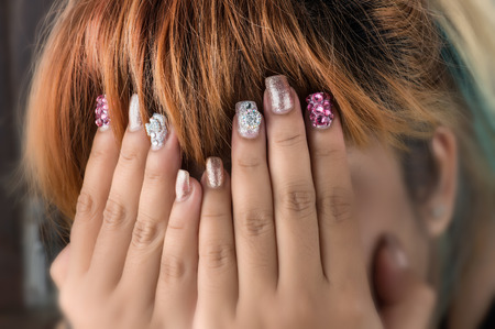 Asian young girl homemade fasion nail by oneself in funny time for girl.