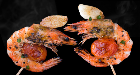 Skewer barbeque grilled prawns with spicy ingredients garlic and tomato  isolate for idea concept. Stock Photo