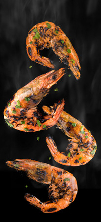 Barbeque grilled prawns with spicy ingredients isolate for idea concept.