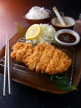 Deep fried pork in Japanese style name tonkatsu set. Reklamní fotografie - 104417856