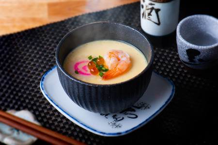 Japanese steamed eggs with shrimp and other topping. Reklamní fotografie - 115465911