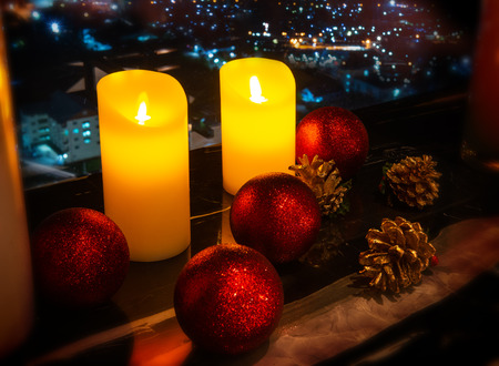 Celebration candles and table decorate wit indoor low lighting and dark shadow.