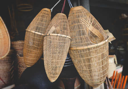 Hand made bamboo basketry for fishery tool with indoor low and warm lighting.