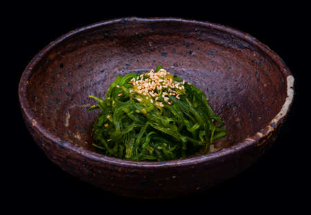 Japanese seaweed salad or hiyashi sugar wakame with black background.