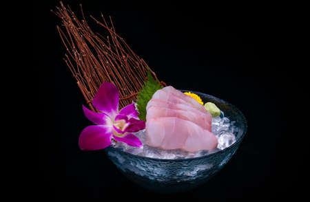 Japanese Tai fish sashimi serving with ice and black background. Archivio Fotografico