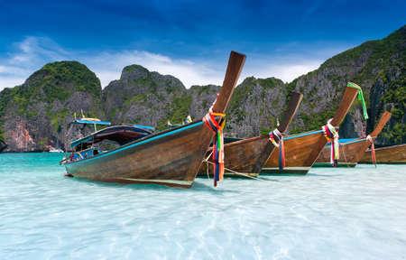 Andaman sea Phi phi leh maya island and longtail boat with sun lighting.